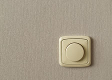 Light switch on a background grey wallp Royalty Free Stock Photos