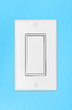 Light switch on blue wall Royalty Free Stock Photography
