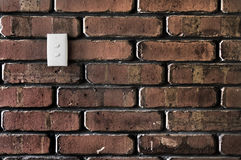 Light switch on a Brick wall Royalty Free Stock Photography