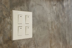 Light switch. On cement wall background Stock Image
