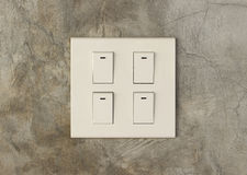 Light switch. On cement wall background Royalty Free Stock Images