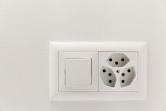 Light switch and electrical outlet. Interior home, light switch and electrical outlet royalty free stock images