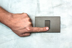 Light switch and finger. Light switch being off/on by index finger stock photography
