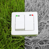 Light switch on a green grass background Royalty Free Stock Photography