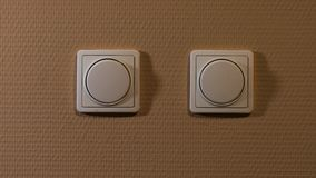 Light switch on and off. Light switch turned on and off stock footage