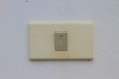 Light switch on the old wall Royalty Free Stock Images