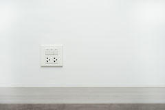 Light switch and power outlet Stock Photo