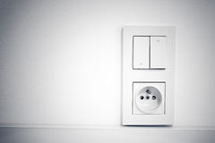 Light switch and socket on the wall Royalty Free Stock Photography