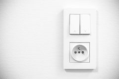 Light switch and socket on the wall Royalty Free Stock Image