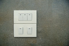 Light Switch on surface cement in Thailand. Light Switch on surface cement texture & background, wall background Stock Photography
