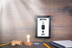 Light switch is switched from off to brand. business opportunities and success concept.  Stock Image
