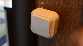Close Up of Caucasian Male Hand Clicking the Light Switch On Off, Top View stock video footage