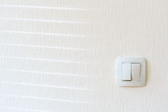 Light switch on the wall. Stock Photos