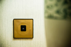 Light Switch on Wall Stock Photo
