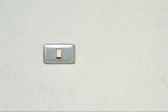 Light switch on wall Stock Photos