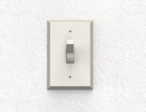Light switch  on a wall Stock Photography