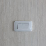 Light switch / White light switch on white wall / Concept / On O Stock Photo