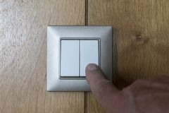 A light switch on the wooden wall Stock Images