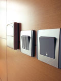 Light switches. Modern style light switches at home Stock Photos