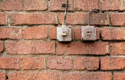 Light switches on brick wall Stock Photography
