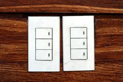 Light switches on a concrete wall Stock Image