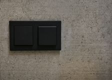 Light switches on wall. Space for text royalty free stock image