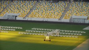 Light system for growing lawns at an empty football field stock footage