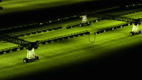 Light system for growing lawns at an empty football field. stock video