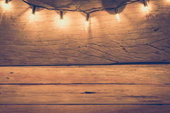 Light on the table made of antique wood trim to the end of Chris Stock Photos