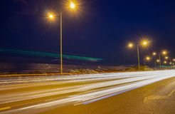 Light Tail of Car on Highway with blue sky. Light Tail of Car on Highway Long exposure shot Royalty Free Stock Images