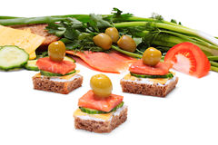 Light and tasty snack. Of bread, cheese, smoked salmon and olives. With a depth of focus across the frame Royalty Free Stock Images