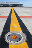 Light on taxiway. Broken light on the airport taxiway Royalty Free Stock Photos