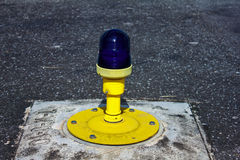 Light on taxiway. Ground side lamp taxiway at the airport Royalty Free Stock Photography