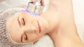 Light therapy procedure. Heal beauty treatment. Woman facial device. Anti age and wrinkle.  stock photo