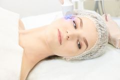 Light therapy procedure. Heal beauty treatment. Woman facial device. Anti age and wrinkle.  stock image