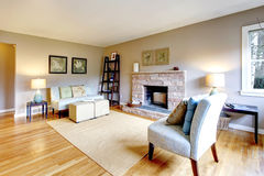 Light tones living room with a fireplace Stock Images