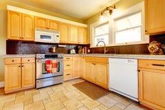 Light tones wood kitchen with brick backsplash design Royalty Free Stock Photos