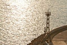 Light tower facing the ocean Stock Photos