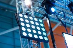 Light tower lit at a stadium during nightime. Light tower lit at a stadium during nightime Stock Photos