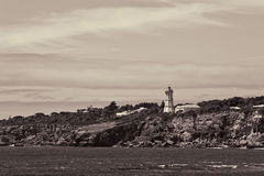 Light tower at shore Royalty Free Stock Image