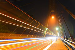 Light traces of the bridge and the car Royalty Free Stock Image