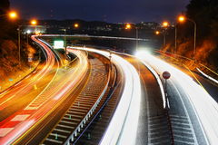 Light traces of highways and cars. It is a light trace of a highway and a car Royalty Free Stock Photos