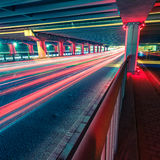 Light traces on traffic junctions at night Stock Photography