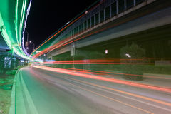 Light traces on traffic junctions at night Stock Images