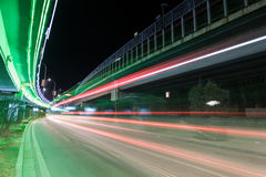 Light traces on traffic junctions at night Stock Image
