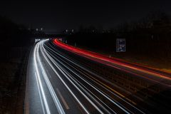 Light tracks of cars on a motorway, Germany royalty free stock photos