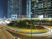 Light Traffic in the City. Light traffic strips and comercial buildings in Hong Kong at night Stock Photography