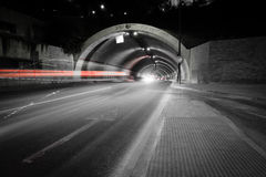 Light trail. Car lights trail in a tunnel in Malaga, Spain Stock Images