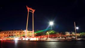 Light trail around Giant swing at night in Bangkok Stock Photo