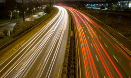 Light trail on a busy motorway. A light trail on a busy motorway stock photos